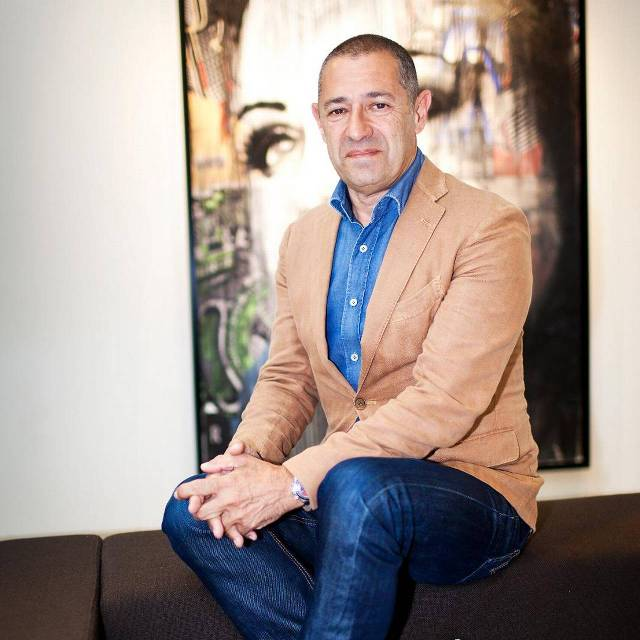 Roland Kahn, eigenaar van kledingbedrijf CoolCat. Foto Ilvy Njiokiktjien / Hollandse Hoogte
