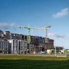 In de Amsterdamse Houthavens worden zowel koop- als huurwoningen gebouwd. (HH)